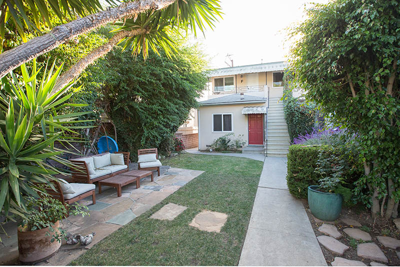 Sweet 1BD Near Montana Ave with Peek A Boo Ocean Views and Balcony!