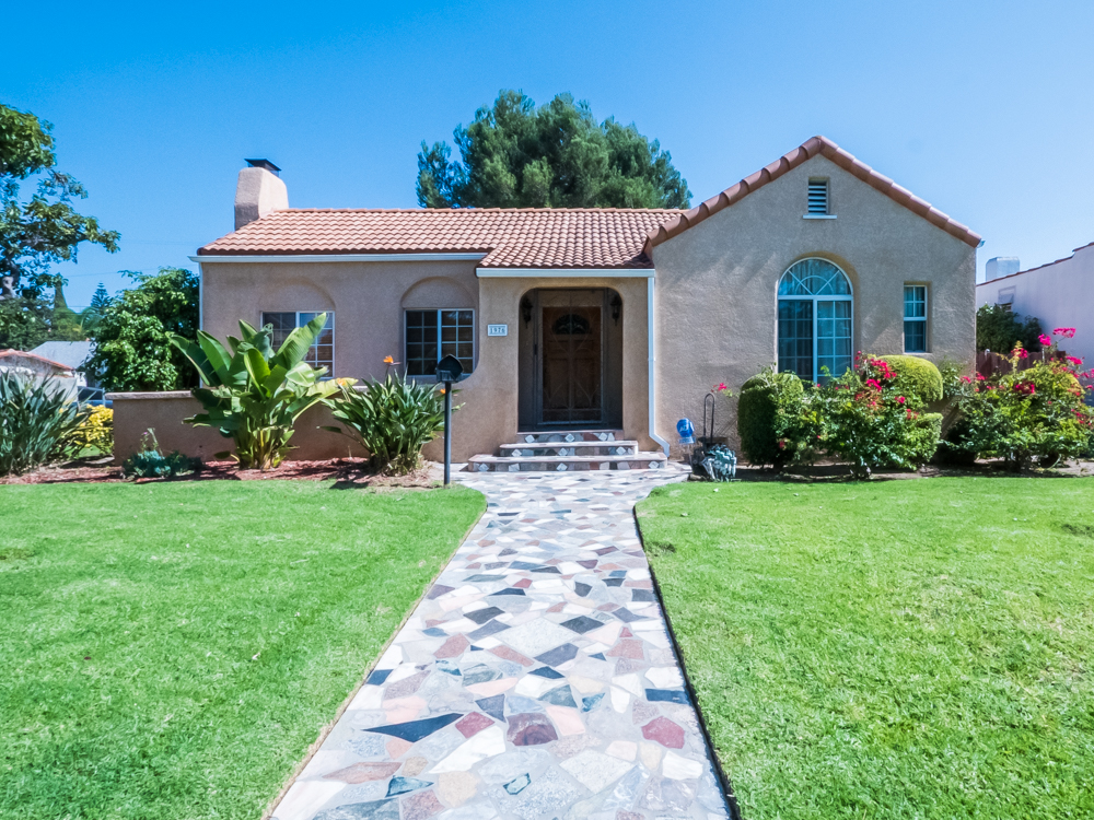 Beautifully Landscaped Single Family Home | Lush Front Yard & Fenced In Backyard | Bright & Inviting |Garage Parking