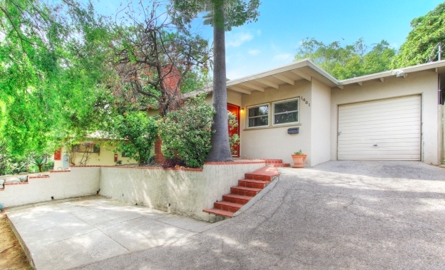 Drive up the private drive to this mid century ranch and you will immediately sense the seclusion and tranquility of living a top this hillside.